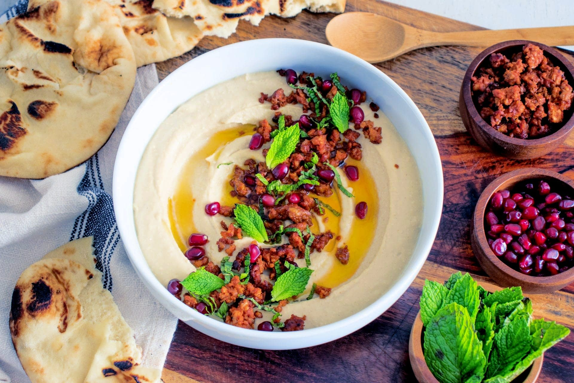 Olive Oil Hummus with Lamb Sausage, Mint & Pomegranate