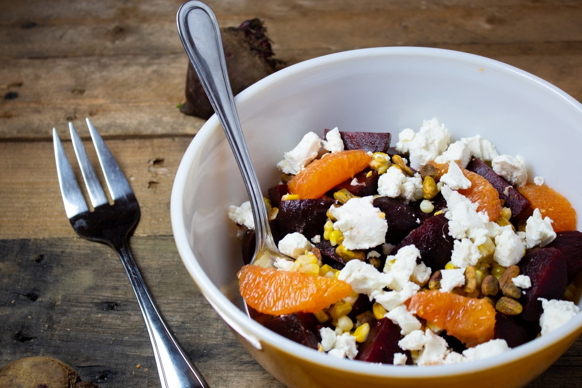 Roasted Beet Salad with Sweet Corn, Goat Cheese, and Pistachios